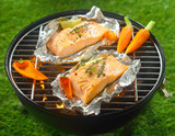 Grilled salmon steaks with baby vegetables