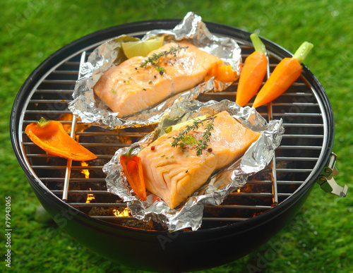 Fotobehang Barbecue Grilled salmon steaks with baby vegetables