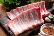 Raw Pork Rib Meat on Wooden Cutting Board - 79943419