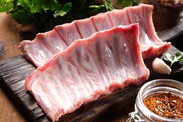 Raw Pork Rib Meat on Wooden Cutting Board