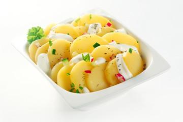 Creamed Boiled german Potato salad on White Bowl