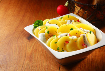 Gourmet Potato Dish on Bowl with Cream and Spices