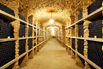 Old cellar of the winery Bottles of wine in the future Huge ware
