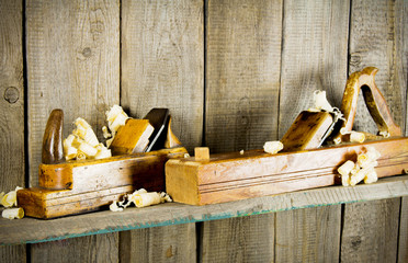 old tools on a wooden shelf.