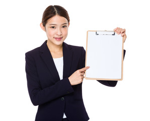 Happy smiling beautiful young business woman showing blank clipb