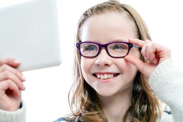 Girl trying new glasses.