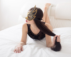 girl in mask on white bed