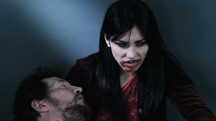Sad female vampire with dead boyfriend attacking camera