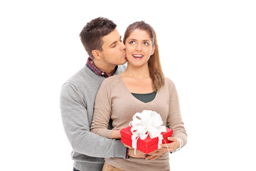 Man giving a present to his girlfriend and kissing her