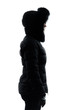 woman winter coat standing profile silhouette