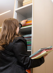 Business woman classifying documents