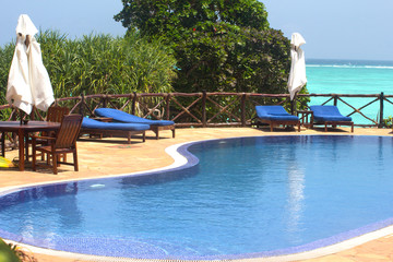 Swimming pool with sunbeds and umbrellas