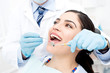 Leinwandbild Motiv Female getting her teeth examined