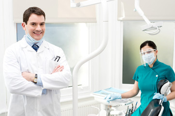 Male dentist with female assistant