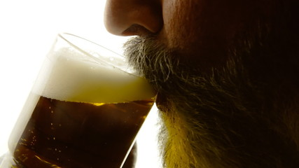 Beer silhouette beard close-up thirst