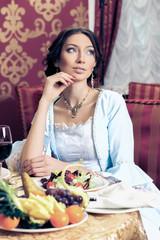 Girl in vintage dress in the restaurant.