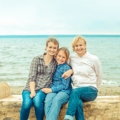 mother and her two daughters on the shore