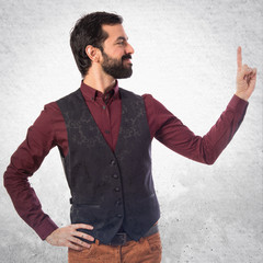 Man wearing waistcoat pointing up