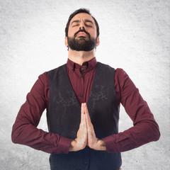 Man wearing waistcoat in zen position