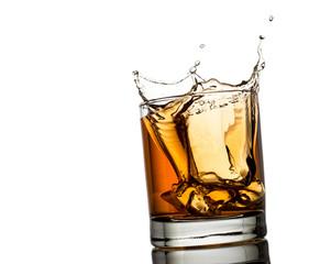 splash of whiskey with ice osolated on white background