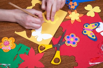 Woman hands who create shapes and designs for children