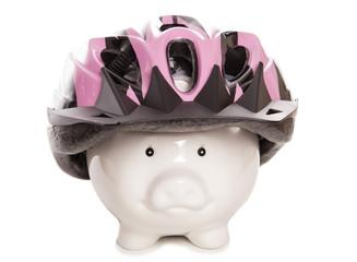 piggy bank wearing cycling helmet