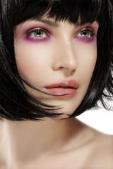 Beauty model hairstyled  and pink eye shadows makeup  closeup