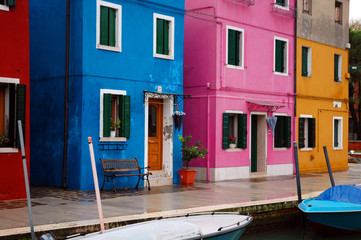 Burano island in Venice, colorful houses.
