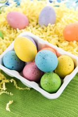 colored Easter eggs in white carton