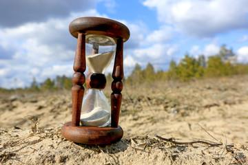 Hourglass on sand