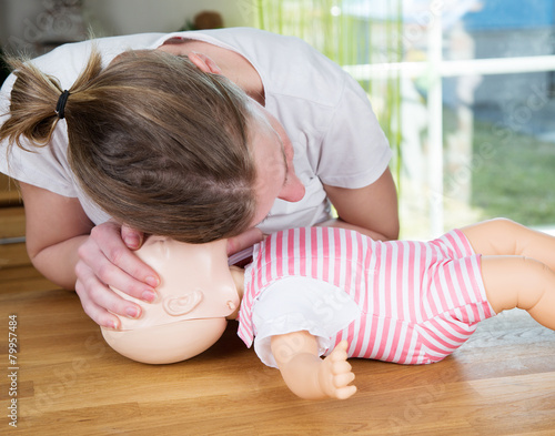 Baby CPR check for signs of breathing - 79957484