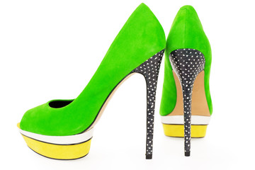 Pare of bright green and yellow high heel shoes isolated on whit