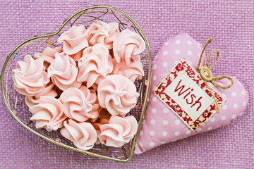 Pink meringue in heart shaped basket with soft fabric heart by,