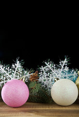 branch of fir-tree, snowflakes and new-year decorations