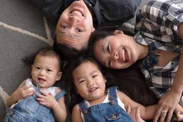 Asian family smiling and laughing