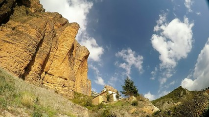 time lapse of a big cliff with small monastery in the village