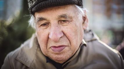 Seniors portrait, sad elderly man looking at camera