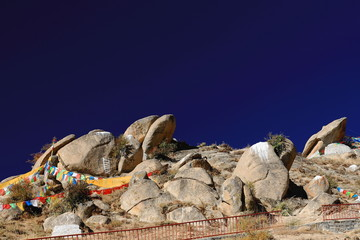 Prayer flags and mani stones. Drepung monast.-Tibet. 1212