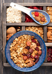 granola, oatmeal, berries and nuts. top view