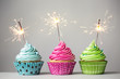 Three cupcakes with sparklers - 79966298