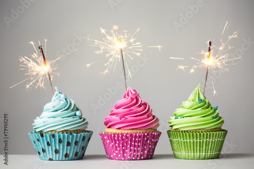 Three cupcakes with sparklers