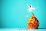 Orange cupcake with sparkler