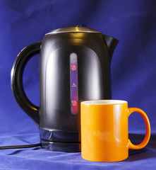 electric tea kettle and a mug
