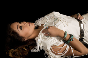 Native American woman in white outfit lay on black head look