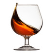 Splash of cognac in glass - 79968486