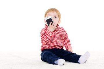Sweet small baby with mobile phone.