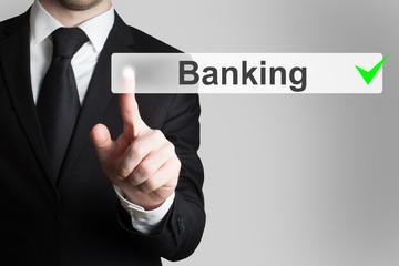 businessman pushing button banking