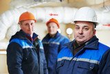 heating engineer repairmans in boiler room