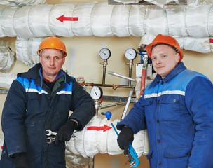 heating engineer repairmans in boiler room
