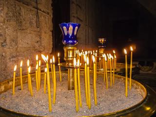 Burning Candles inside Stoned Chapel